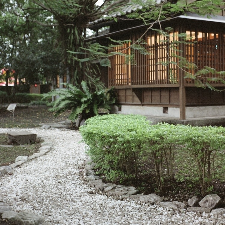 House on struts and gravel path