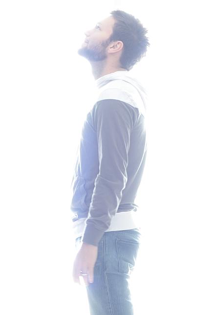 Man stood in light glare